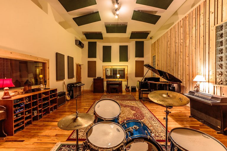 Rift Studios Live Room with Yamaha C3 grand piano, vintage Gretsch drum kit, Wurlitzer, Rhodes, and Hammond organ.